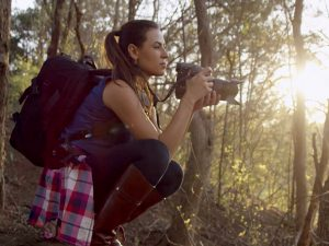 artist laura cope on location photographing with a camera shooting nature