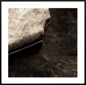 abstract macro photo of body of water and rock