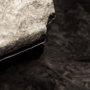 abstract macro photo of flowing river and rock