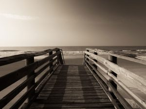 pier overlooking ocean waves in Folly beach south carolina coast