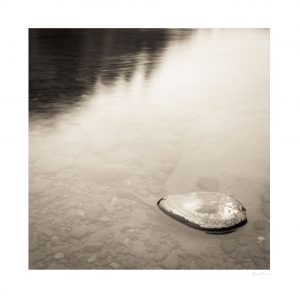 rock submerged in body of water | macro photography print