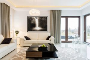 living room with waterfall framed photography print by laura cope on wall